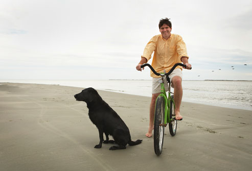 Man Riding Bike On Beach